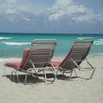 Two red chairs in paradise