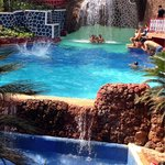 The swimming pool with waterfall