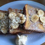 French Toast with fresh bananas and macadamia nuts. Be sure to eat with Coconut syrup!