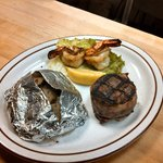 5 oz filet with 2 Cajun prawns and tin taters on the side a special they run