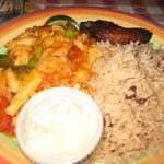 Caribbean Conch dish with plantains and rice and beans