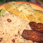 Conch steak with plantains and rice and beans