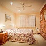 Main bedroom, queen size bed, walk-in wardrobe, overhead fan