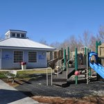 bathhouse with playground in front (campground)