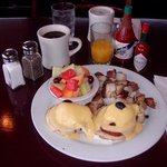 its eggs benedict on a crowded sunday with a rain storm.