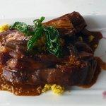 Slow Braised lamb ribbetjies with orange mint coucous & sweetcorn & pea chutney