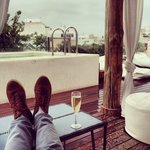 Champagne by the rooftop pool.