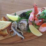 Beautiful presentation of seafood on a little surfboard!