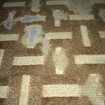 shabbily carpet in a very shabbily room