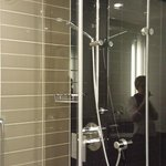 Clean and modern bathroom with a powerful shower