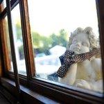 Angel peeping through diningroom window
