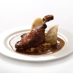Roasted duck leg with caramelized cabbage and homemade potato-onion dumplings