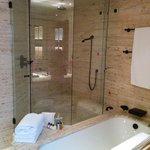 Italian limestone in the bathroom w/ shower + tub.