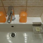 soap and glass is ensured in bathroom