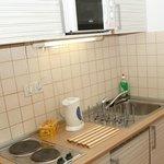 Fridge, freezer, hotplate, microwave, water boiler are ensured.