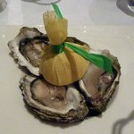 Three pieces of oysters Fine de Claire on ice with lemon