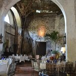 ceiling of vines creates a dreamy dining experience