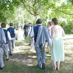 bridal party walking through the gorgeous gardens