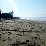 on the beach walking toward marcket