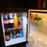 fridge with juice, soda, beer, and liquor