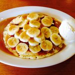 Pancake smothered in bananas with ice cream & caramel topping