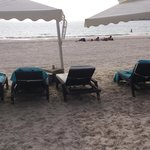 A third sun bed under the umbrella is to close for comfort