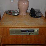 Clock radio and bedside table off the arc