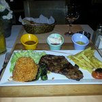 Beef steak with two sides and  choice of three sauces