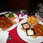 room service food, beer battered fish and chips and chicken drumlets with blue cheese and bbq di