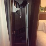 The closet had iron, iron board and safe.
