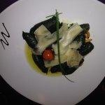 Spinach ravioli with parmesan.