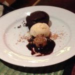 The amazing dessert, spiced chocolate cake with peanut butter and coconut truffle complimented w