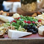Cheese, nut, and salad spread at a catered event at the B&B