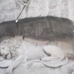 dying lion statue