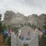 Mount Rushmore with the flags