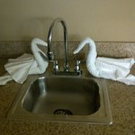 Towel swans at the kitchenette sink