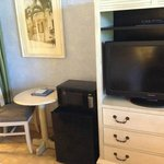 Small table, frig & microwave.  TV and dresser