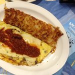 Chili and cheese omelet with hash brown yum!