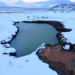 Swimming in a remote thermal pool