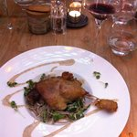Duck leg confit served with oriental style soba noodles and bok choy