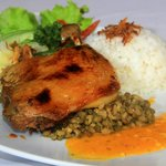 a roasted duck marinated with indonesian spices,with orange sauce