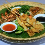 a special grilled of squid,fillet fish,and king prawn
