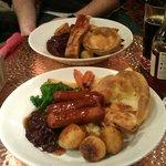 belly pork and veggie sausage roast dinners