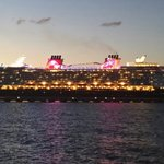 Newest Disney ship sailing away...View from the terrace.