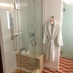 bathroom w/ rainfall shower w/ two seats and robe