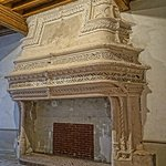 A monumental stone fireplace added to the ceremonial hall of the abbey during the Renaissance