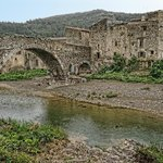 """A view of the 13th century """"Old Bridge"""" spanning the Orbieu River in Lagrasse"""