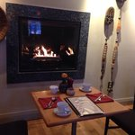 Breakfast by the fireplace at Zees