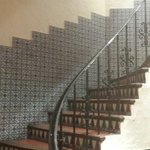 Sevillano ceramics line the walls and staircases