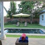 The pool set in quiet gardens.